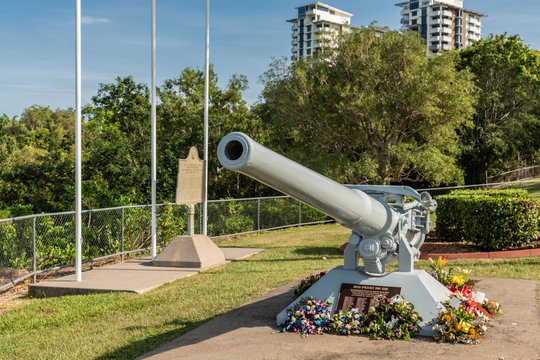 Darwin Australia - February 22, 2019: USS Peary war memorial in Bicentennial park along shore of Darwin Harbour has cannon pointing to the place where the Clemson-class destroyer rests under the water