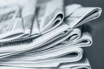 News concept, folded newspaper closeup. Wall mural