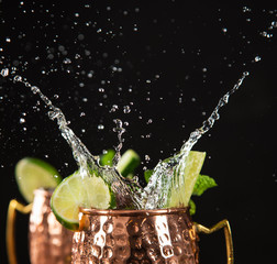 Printed roller blinds Splashing water Famous splashing Moscow mule alcoholic cocktail in copper mugs.