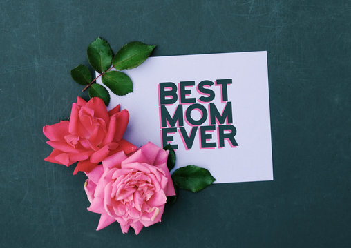 Best mom ever top view of card for mothers day with pink roses.