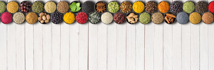Fototapete - Seasonings and herbs for delicious food. Spices on white table background with empty space
