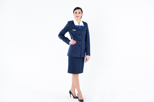 Portrait of a full-length stewardess on a white background