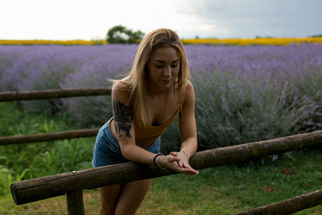 Pensive and lonely woman in a Lavender field