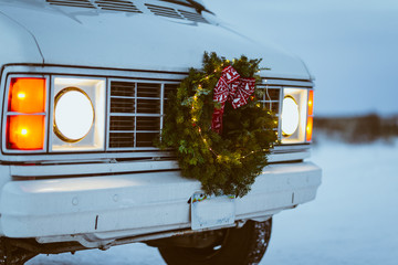 Front of vintage white van with christmas wreath