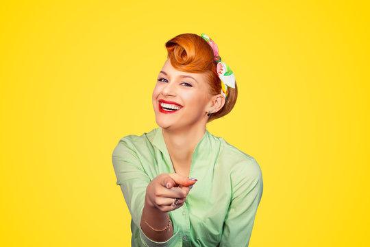 pinup girl pointing at you smiling laughing