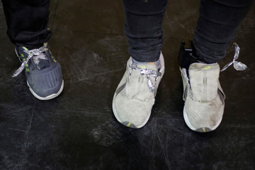 An ankle monitor is seen on the foot of a Central American woman at Vino Nuevo church, which gives temporary shelter to migrants released by U.S. Customs and Border Protection due to overcrowded facilities, in El Paso