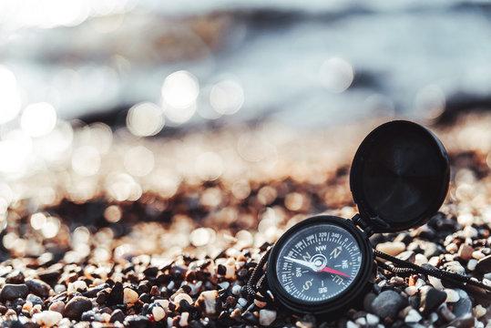 Compass on a sandy beach