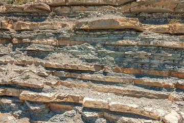 Natural corrugated stone layers closeup background