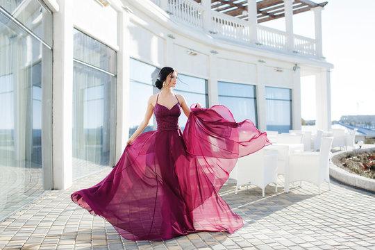 Beautiful woman in elegant evening dress. Beautiful young woman, model, in an evening dress outdoors.A portrait of a beautiful elegant woman in the evening dress. Fashion, evening dresses for events.