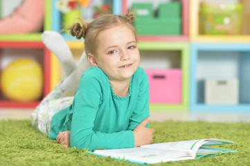 Portrait of a cute happy schoolgirl studying