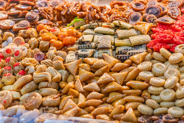 Bees over a street food stand of sweet delights in Marrakesh, Morocco