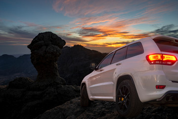 SUV driving on mountain off-roads Wall mural