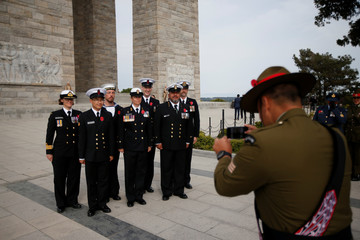 New Zealand soldiers pose for a souvenir picture during an international service marking the 104th anniversary of the WWI battle of Gallipoli at the Turkish memorial in the Gallipoli peninsula in Canakkale
