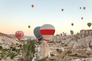 Hot air balloons flying over rock landscape at Cappadocia Wall mural