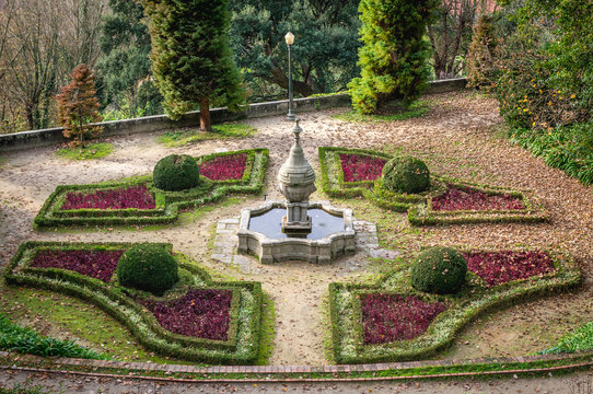 Fountain and alleys of Crystal Palace Gardens public park in Porto, Portugal