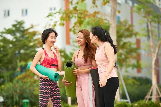 Women discussing yoga classes