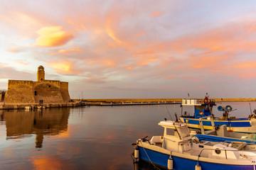 Italy, Marina di Ostuni, sunset at the port of Villanova