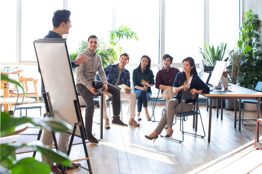 Students listening to teacher during seminar at university