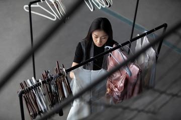 Fashion stylist working in studio