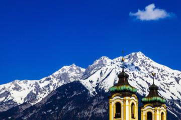 church spires with alpine mountain background