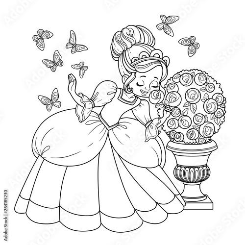 Beautiful princess sniffs a rose flower and butterflies