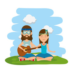 hippies couple playing guitar in the field