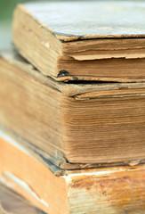 Vintage old books, vertical close-up background