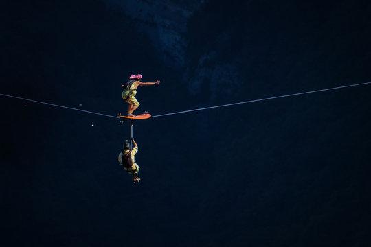 two people surfing on a line during a base jump session, Auvergne-Rhône-Alpes, Saint-Julien-en-Vercors, France