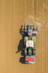 Fototapeta farming maize sowing tractor on dry field in southern germany aerial top down view obraz