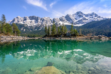 Reflections of Zugspitze mountain in turquoise Eibsee lake, Garmisch-Partenkirchen, Bavaria, Germany Wall mural