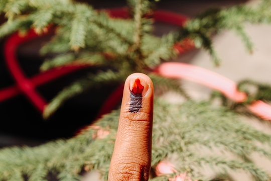 Closeup Shot of the finger of the Indian man marked with ink showing depicting that he gave his vote