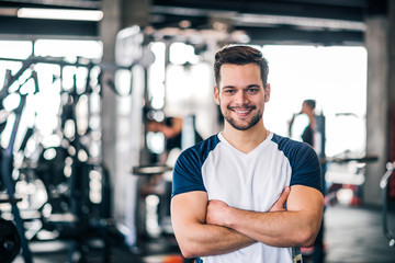 Portrait of a personal trainer in sportswear at the fitness center or gym.