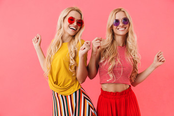 Picture of Pleased blonde twins in sunglasses having fun