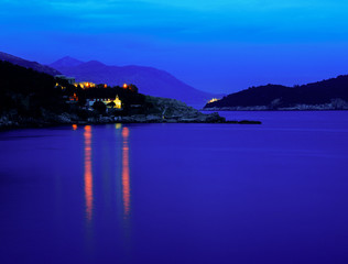 Canvas Prints Violet Moody landscape. Evening at the Mediterranean Sea with a view on the Dubrovnik lights, Lokrum island and distant mountains.