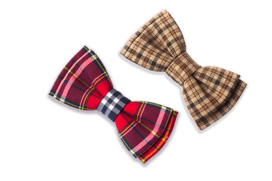 Brown checkered bow tie on a white background. Men's and women's accessories. Hipster style