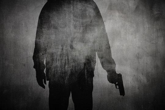 Silhouette von einem Mann mit Pistole