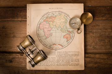 Binoculars and Compass on 1870 Map of Eastern Hemisphere – World Travel
