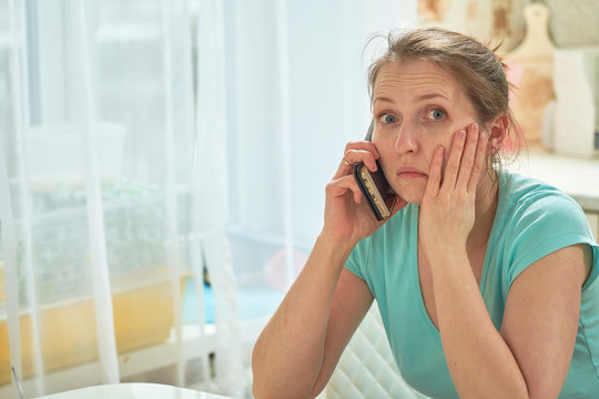 the woman calls the doctor severe toothache. terrible news on the phone. desperate look hopelessness