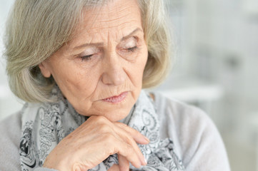 Close up portrait of sad senior woman