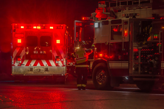fire truck, firefighter, ambulance responding to car crash at night
