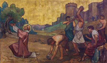 PRAGUE, CZECH REPUBLIC - OCTOBER 17, 2018: The stoning of St. Stephen freso in the church kostel Svatého Cyrila Metodeje by  S. G. Rudl (1896). Wall mural