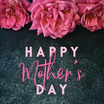 Happy Mother's day graphic with pink roses on black background, text for holiday banner.