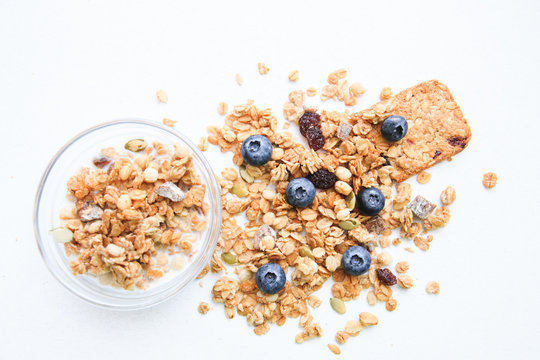 Crunchy muesli and blueberry Breakfast cereals isolated on white background, selective focus, top view