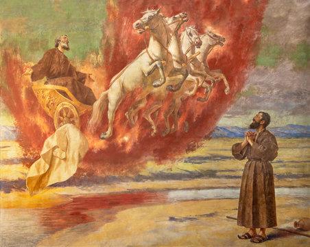 CATANIA, ITALY - APRIL 7, 2018: The fresco Prophet Elias ascending into Heaven in the chariot of fire in church Santuario della Madonna del Carmine by  Natale Attanasio (1898).