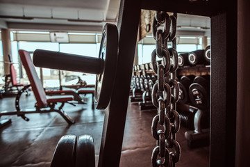 Photo of sport equipment in trendy sunny gym. Fototapete