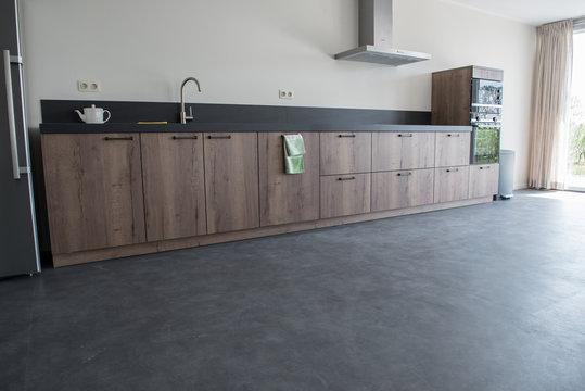 Luxury kitchen with PVC concrete look flooring