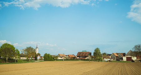 Beautiful clean wealthy French village of Benfeld with multiple houses, construction crane large...
