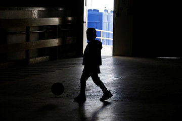 """A child from Central America plays inside the """"House of the Refugee"""", which gives temporary shelter to migrants released by ICE and U.S. Customs and Border Protection (CBP) due to overcrowded facilities, in El Paso"""