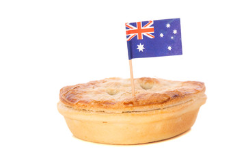 A traditional Aussie meat pie with an Australian flag.
