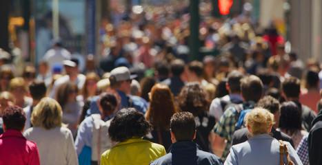 Crowd of people walking busy street in New York City